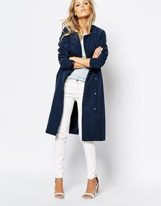 Blue is about the most color you will see in my wardrobe, because I like to collect staple pieces that I'll wear forever, like this ASOS duster trench ($105) in an overdyed navy. It has a Japanese indigo look to it, and I'm obsessed with the clean lines of the collarless silhouette.  — Meg Cuna, style director