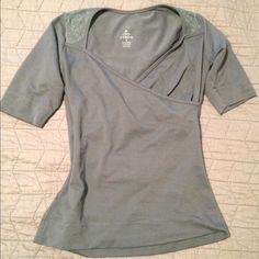 Super soft Prana top Only worn a couple times. Mint condition. Softest material ever. Figure flattering wrap style. Gorgeous detail around shoulders and back. Photos aren't accurate on the color; it's a much deeper sea green. Really pretty. prAna Tops