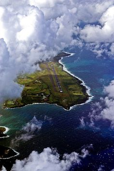 A break in the clouds reveal Lihue airport in Kauai, Hawaii.