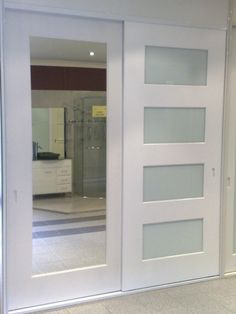 closet doors with horizontal glass mirrored doors with wide trim perfect