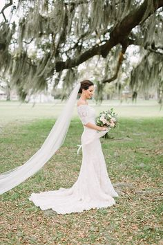 Classic Southern wedding from Southern Wedding. All Lace Wedding Dress from Essense of Australia