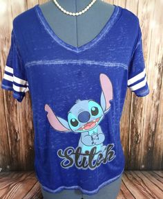 Very cute!  Lilo and Stitch Blue shirt, very sheer (will need an under shirt) straight from the Disney Store.   Little stich missing from collar of shirt*  Hi-lo design     Please let me know of any questions before purchasing.   We only ship internationally through GSP.    Thank You! | eBay!
