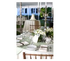 Wedding table setting on spearmint-toned linen