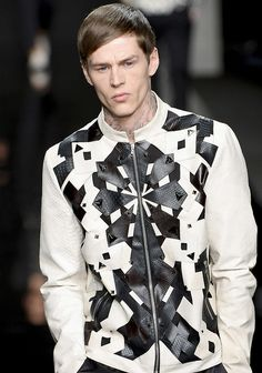 tumblr_mox357Kjcd1rw59xto1_500.jpg (500×713)... Men's white jacket with leather and stud abstract shapes detail.