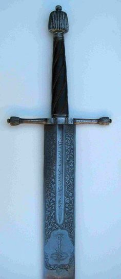 Executioner's Sword Dated: circa 1600 Culture: German Measurements: broad blade (8cm). Length 117 cm The swords features floral ornaments and stylistic gallow and wheel.  Source: © 2013 Historica Arma