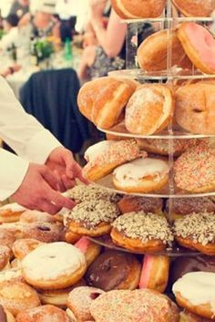 A donut display:   23 Brilliant Wedding Wedding Bars From Couples Who Dared To Dream