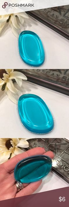 Turquoise Square Jewel Beauty Blender Sponge Turquoise Square Jewel Silicone Makeup Sponge For Blending Foundation Concealer Highlighter.   Apply a small amount of your desired product and blend like you are using your brush or beauty blender, but with less product!! Made of silicone and encapsulated in a super-flexible material.   Amazing new Makeup product everyone is raving about! The best part is that hypoallergenic and sterile due to your product having nowhere to be absorbed in your…