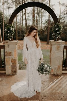 | long-sleeve bohemian wedding dress | boho wedding gown | natural wedding dress | wedding gown with bell sleeves | natural bohemian wedding dress | ivory wedding gown | 2019 wedding dress trends | brides of houston | photo taken at THE SPRINGS Event Venue. follow this pin to our website for more information, or to book your free tour! SPRINGS location:  Pinehaven in Magnolia, TX photographer:  Tyler Rebekah Wright #weddingdress #weddinggown #weddingstyle #bohobride #weddingdecor… Low Key Wedding Dress, Boho Wedding Dress Bohemian, Wedding Dress Trends, Boho Bride, Wedding Dress Styles, Wedding Gowns, Ivory Wedding, Magnolia, Houston