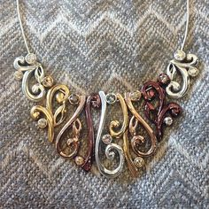 The beautiful mix of silver, gold, rose gold and dark copper colors make this necklace perfect for fall.  #ShopNicoles