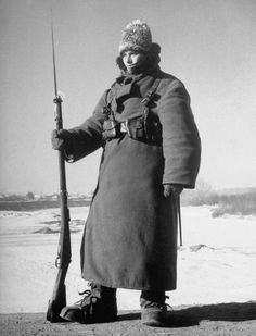 Romanian Officers Training College Rumanian Army guard, clad in cold weather gear, during sentry duty on the bridge over the frozen Prut River in 35 degree-below-zero weather which makes it impossible for him to be on more than an hour at a time. Location: Teghina, Romania Date taken: 1940 Photographer: Margaret Bourke-White