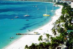 The renowned two-mile-long strip known as Palm Beach Aruba* is home to glamorous high-rise hotels in Aruba and dotted by water sports concessions, piers, beach bars, restaurants and shops. Calm waters make this a comfortable haven for swimmers and snorkelers.