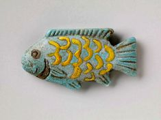 1391-1335 BCE. Faience Fish Amulet to protect from drowning Egypt ca. RISD