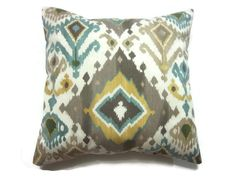 An attractive combination of colors; subtle yet stunning. Decorative pillow cover in teal taupe yellow and light cream. 18x18 inch Ikat Design. Same fabric front and back. Envelope closure. -------------- To view other items in my shop: http://www.lynnesthisandthat.etsy.com ----------- Pillow Inserts not included. Readily available at local craft/fabric stores. ------- Quality Fabrics Dry Cleaning is recommended. Designs may/will vary due to cut. Envelope closure for easy ...