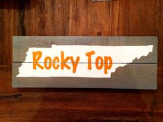 This hand painted TN Rocky Top piece is made of reclaimed pallet wood and is painted gray. The state is white and the letters are TN Vols