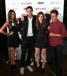 I love that Iain is always unphotogenic in these cast photos.