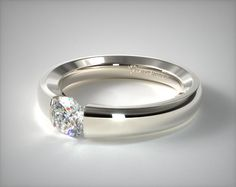 This 14K White Gold Contoured Tension V121 by Danhov Designer Engagement Ring will go great with my multi-faceted tungsten ring.