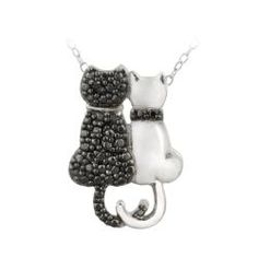 One cat on this pretty pendant showcases a black diamond set within a black rhodium plated faux pave setting and the other cat shines in a high polish finish. This side by side cat necklace is crafted of fine sterling silver.