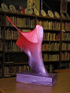 Nylon (knee highs) /Wire (hanger)/ Wood Sculpture