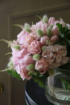Pink and Green floral arrangement with tulips, roses and hydrangeas