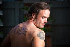 """Psst! DIY Celebs Want to Show You Their Tattoos: The Yard Crashers hottie reveals all: """"The Celtic cross on my shoulder symbolizes unity. The Roman numerals are the year my wife and I got married."""" (Good for him — bad for us!) From DIYnetwork.com.......(Shades of the BDB)"""
