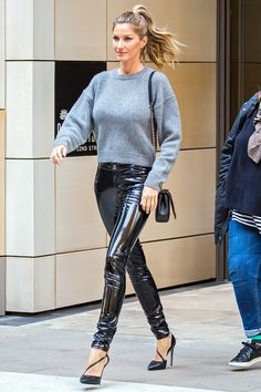 What does a model with the longest legs in the business wear when in a hurry? Spray-on PVC trousers and a casual grey cashmere knit.