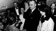 Nov. 22, 1963: White House Photographer Cecil Stoughton captures the moment former Vice President Lyndon B. Johnson is sworn in as president in the cabin of Air Force One by Kennedy appointed Justice Sarah T. Hughes.