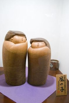 Two brothers Japanese wooden kokeshi dolls