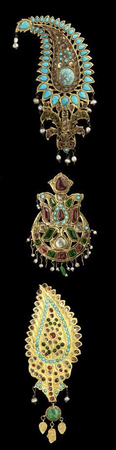 Persia | Three Qajar gold turban ornaments (Jiga); gold, turquoise, emeralds, seed earls, inlaid pastes | ca. 19th century | Est. 3'000 - 5'000£ ~ (Apr '15)