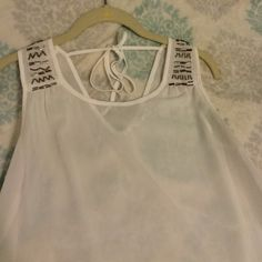 Boutique Top Boutique Top. Shear white tank with jewel beading on the sleeves and open back. Size medium. Tie in the back. Super cute! Tops Tank Tops