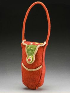 "Lisa Klakulak  Red Arch   17"" x 4.5"" x 4.5"" Photo: Tom Mills  Merino wool fleece, cotton sewing thread, waxed linen, plastic tubing, magnetic closure; wet felted, naturally dyed with Osage Orange wood and Cochineal insects, machine embroidered, hand stitched construction, shellac stiffened"