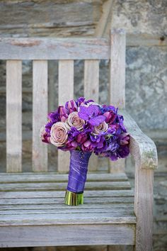 purple bouquet on a bench - wedding photo by top Philadelphia based wedding photographers Langdon Photography