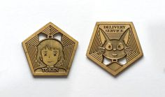 """""""Delivery Service"""" token by artist Bruce Yan available now at spoke-art.com Each double-sided antique gold finished token is only $10!! #BruceYan #SpokeArt #Miyazaki #art #artist #KikisDeliverService #Kiki #Jiji #anime #collectible #token"""