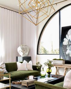 A perfectly balanced room with floor to ceiling linen drapes and touches of brass @serenebe @atlantahomesmag