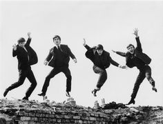 """The Beatles """"Love"""" album and Cirque de Soleil show both use the iconic photo of The Beatles jumping. The Beatles jumping silhouette images are shown in the logo from left to right as Ringo Starr, Paul McCartney, John Lennon and George Harrison. Beatles Mono, Foto Beatles, Die Beatles, Beatles Photos, Beatles Poster, Beatles Art, Hello Beatles, Beatles Funny, The Beatles Help"""