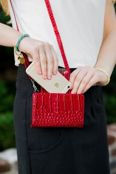 This convertible Buddy Pouch Clutch works as a purse, wristlet, Buddy Pouch, or cross-body purse with a long strap! SHOP NOW!