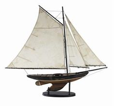 This Newport Sloop is a beautiful pond sailing boat model! A nuatical reproduction of a sloop in deep distressed black and wood, this ship model has stained and antiqued hand made sails and riggings, brass hard ware and rusted nails to accentuate the antique look and feel. Authentic Models $169.99