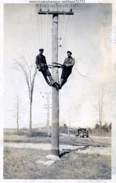 Electric linemen on pole, 1930. Got to love old linemen pics like this!
