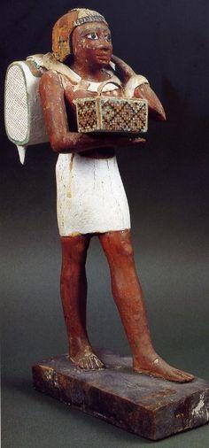 Wooden figure of an offering bearer.