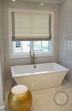 Custom Drapery Designs, LLC- What a perfect spot to slip away and relax!  Roman shade featuring a metallic side trim providing beauty and privacy in this master bathroom.