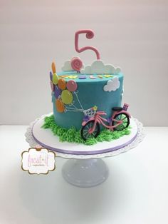 Cute bicycle themed buttercream birthday cake by Frost It Cupcakery