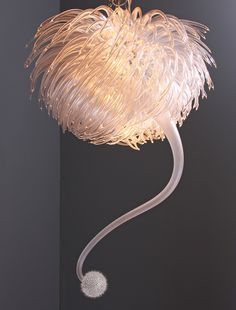 Originally produced for James' graduation show at the Royal College of Art in 2007, this arresting chandelier has become his signature piece. The 400 hand-blown glass components seemingly undulate, calling to mind vines twisting in the wind or a giant sea anemone living among crashing waves.