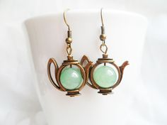 Quirky brass teapot earrings with green aventurine crystal pearls, antique style brass, vintage style, Alice in Wonderland, Selma Dreams sold by Selma Dreams. Shop more products from Selma Dreams on Storenvy, the home of independent small businesses all over the world.