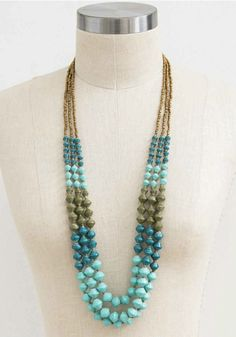 """With three cascading tiers of beads, this bold necklace channels """"tropical getaway"""" vibes and adds a unique touch to your look."""