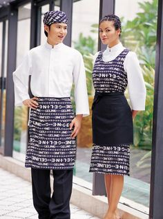 "Idea of Baker and Wife in matching (mix&match) uniforms.""It takes TWO"" etc. Cafe Uniform, Waiter Uniform, Hotel Uniform, Uniform Dress, Chefs, Restaurant Uniforms, Apron Designs, Uniform Design, Textiles"