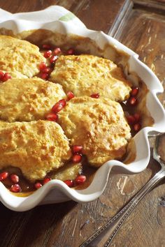 Here's a modern twist on an old-fashioned cobbler. Pears and pomegranates complement each other perfectly to make this a delicious and striking dessert. Pomegranate Recipes, Pear Recipes, Pomegranate Molasses, Lime Recipes, Pear Cobbler, Winter Dishes, Cast Iron Recipes, Thanksgiving Recipes, Food Dishes