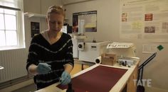 Conservator Rachel Barker working on a replica fragment of Rothko's Seagram mural 'Black on Maroon', defaced in 2012. The sample was painted using Rothko's materials and treated in a special oven that simulates natural ageing over 60 years, then used to test the most appropriate solvents and cleaning methods for restoring the canvas.