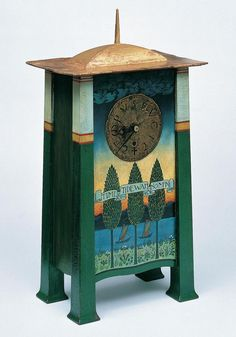 "Charles Voysey clock design  named ""Time & Tide Wait For No Man"", dated in 1895.   Seen as Arts and Crafts style, incorporating roman numerals on the face. By 1901 he exchanged the numerals for the latin phrase Tempus fugit, meaning ""time flies""... an interesting reminder of the clocks function."