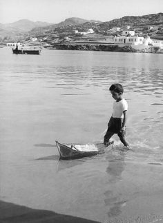 until he's big enough to handle the big boats, he'll practice on the little ones! Mykonos Island, Mykonos Greece, Athens Greece, Santorini, Greece Pictures, Old Pictures, Greece History, Myconos, Old Time Photos
