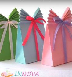 This is a very nice diy craft video tutorial: an easy paper (ribbon) gift bag by innova crafts. with this video you can learn how to make these original Diy Gift Bags Paper, Origami Gift Bag, Diy Gift Box, Diy Gifts, Paper Bags, Small Gift Bags, Small Gifts, Paper Ribbon, Paper Crafts For Kids