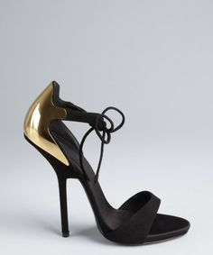 ca5f1eaa7d06e5 I discovered this Giuseppe Zanotti black and gold suede open toe plaque heel  pumps